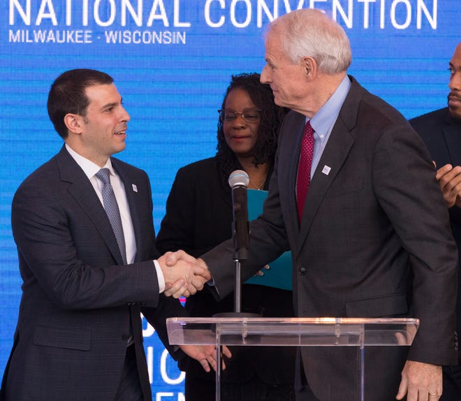 Milwaukee Bucks Senior Vice President Alex Lasry (left) is introduced by Milwaukee Mayor Tom Barrett as U.S. Rep. Gwen Moore looks on during the official announcement that Milwaukee will host the 2020 Democratic National Convention.