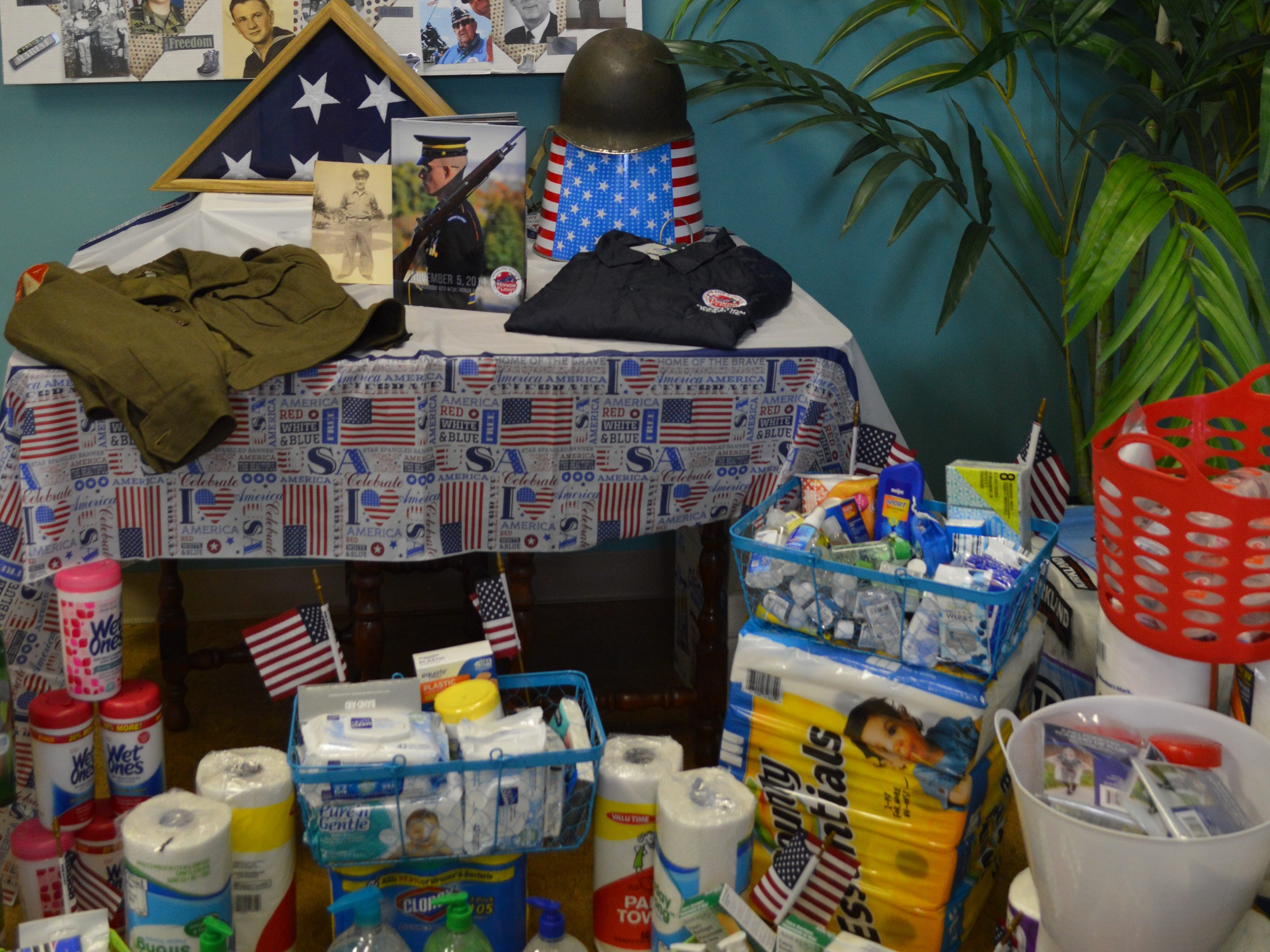 Karissa Vitale Adam, owner of Vitality Massagein Waukesha, is collecting hand sanitizer, travel tissue, paper towel, wet wipes, sunscreen, ponchos, Band-Aids and Depends for veterans going on Stars and Stripes Honor Flights.