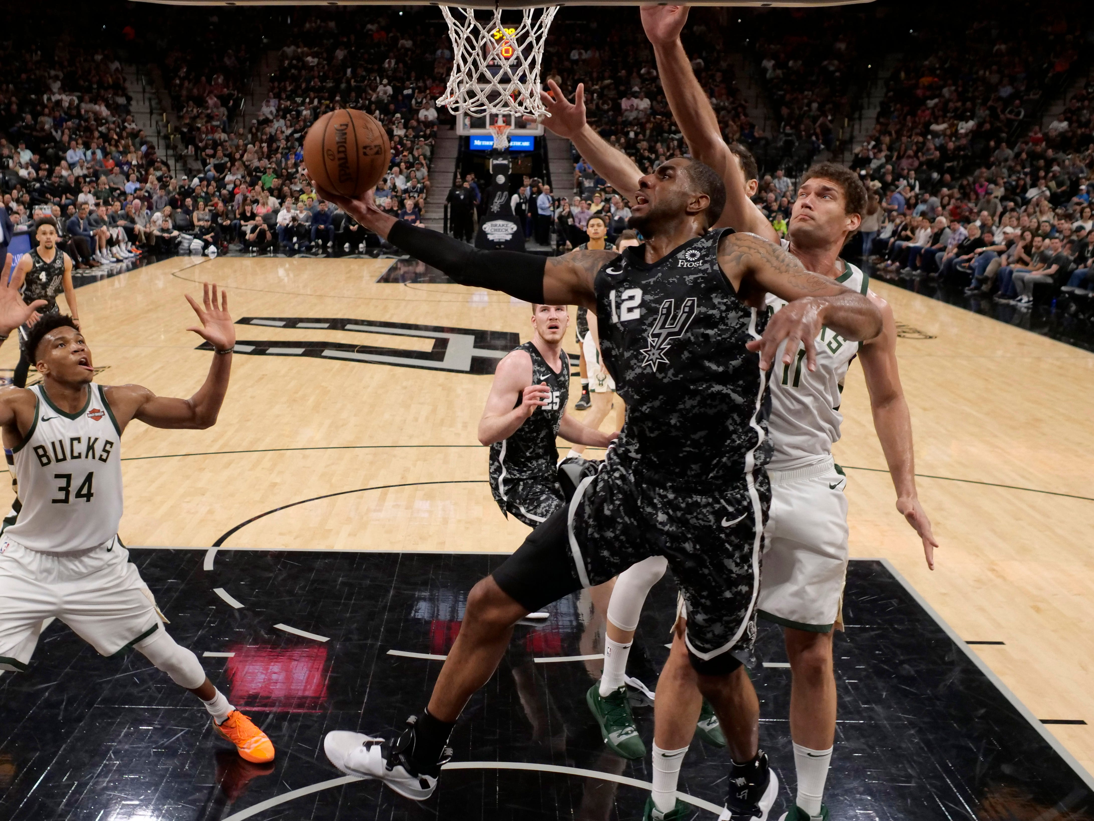 Spurs power forward LaMarcus Aldridge goes up for two of his game-high 29 points against the Bucks on Sunday night.