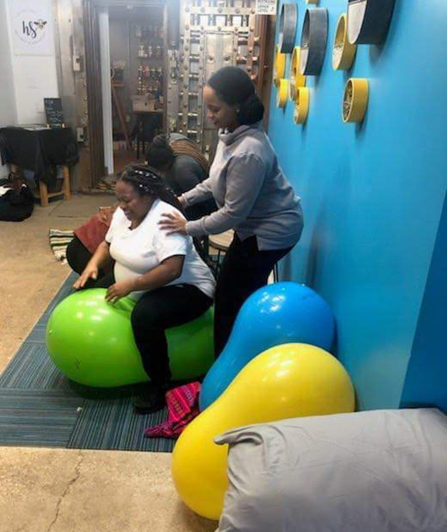 """Doulas help mothers throughout pregnancy and birth with a variety of techniques, many of which will be demonstrated at the """"It takes a village: Community baby shower & resource fair."""""""