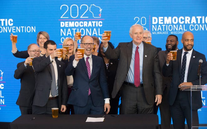 Democratic National Committee Chairman Tom Perez (center) hoists a beer with Milwaukee Bucks Senior Vice President Alex Lasry (left), Milwaukee Mayor Tom Barrett and Lt.  Gov. Mandela Barnes following the official announcement that Milwaukee will host the 2020 Democratic National Convention at Fiserv Forum on Monday. Milwaukee snagged the event over Houston and Miami.