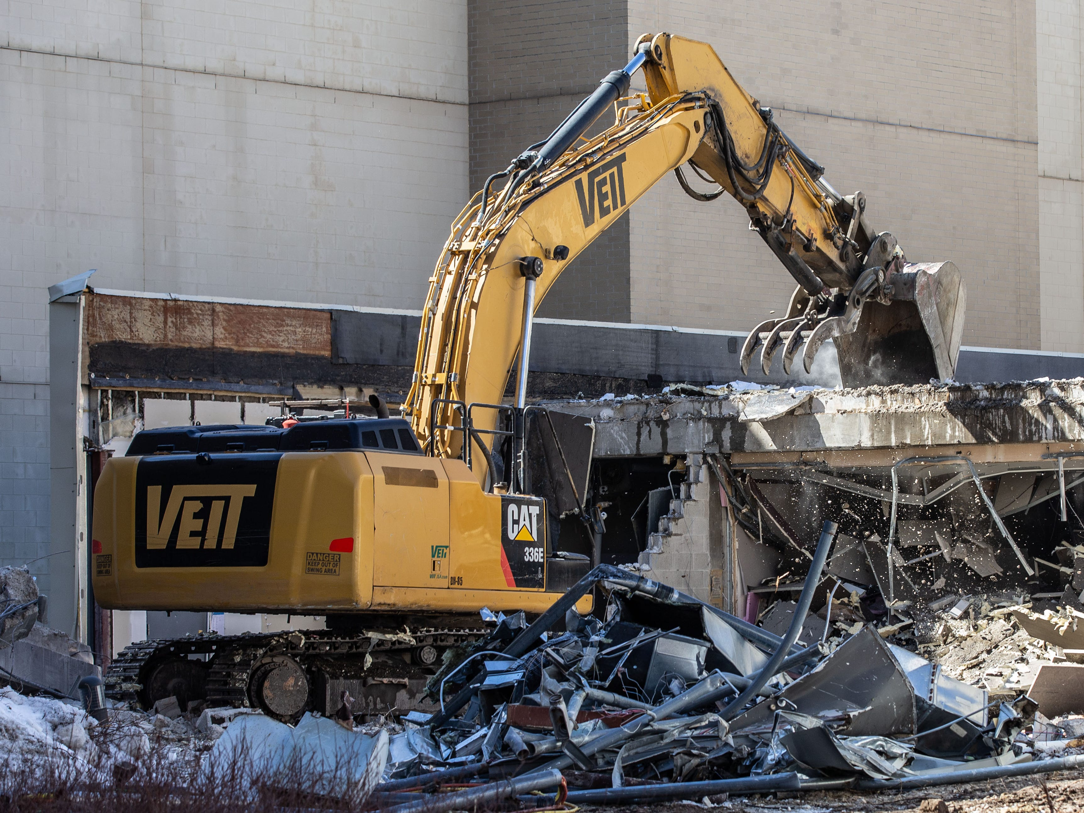 Crews work to demolish the old Waukesha County intake court building on Monday, March 11, 2019. The 52,000-square-foot building at 515 W. Moreland Blvd. is being removed to make way for construction of a new 62,000-square-foot secure courtroom addition.