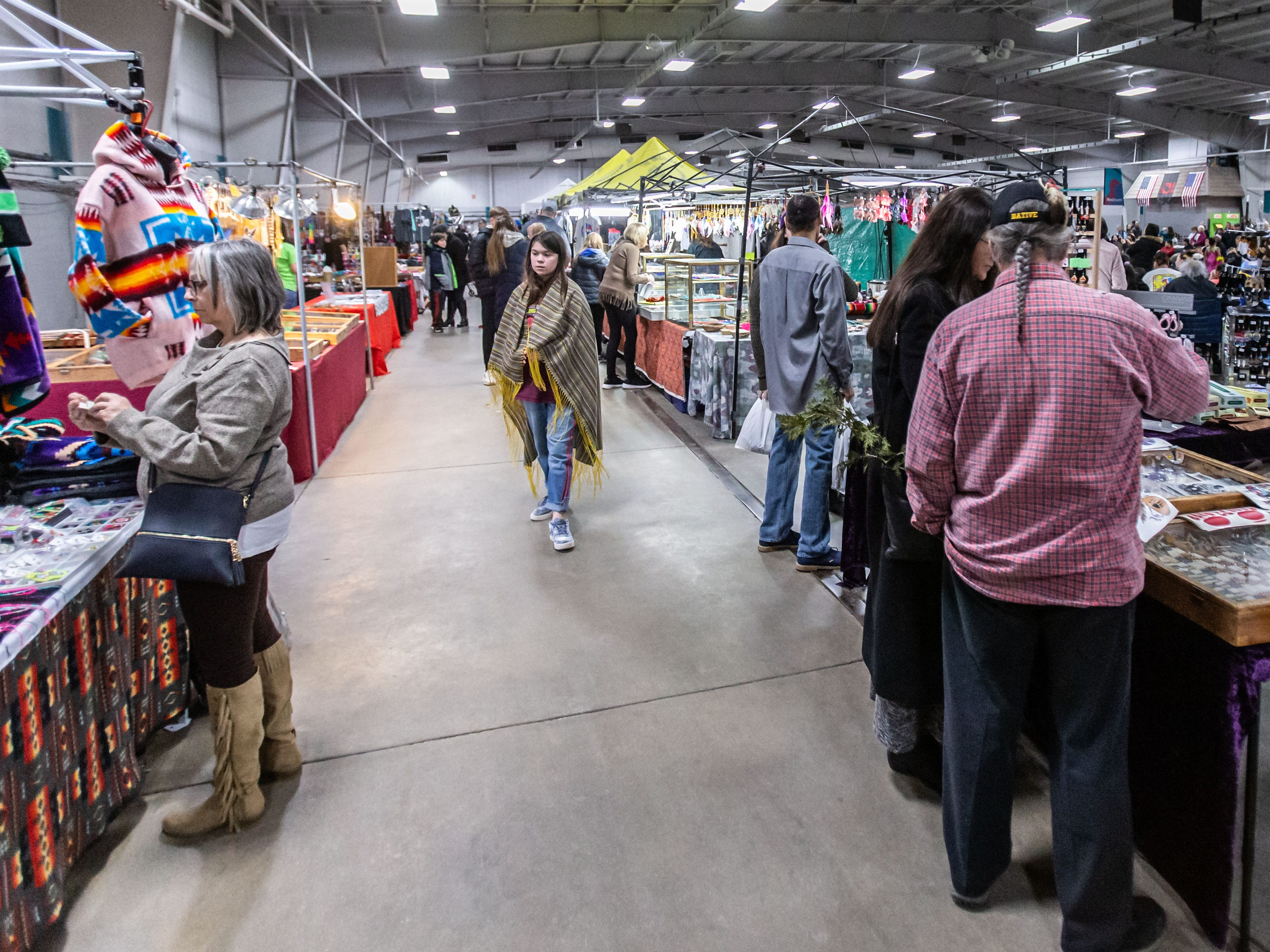 Visitors shop for Native American jewelry, clothing and art during the Indian Summer Festival's 28th annual Winter Pow Wow at Wisconsin State Fair Park on Sunday, March 10, 2019.