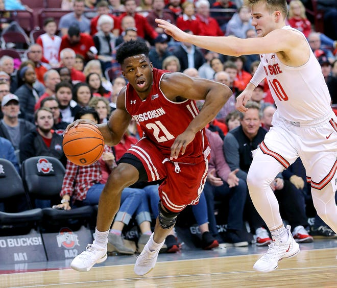 Badgers guard Khalil Iverson blows past Ohio State forward Justin Ahrens on a drive to the bucket during the second half.