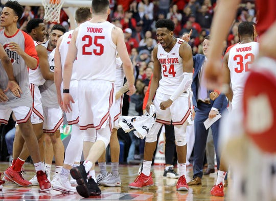 Andre Wesson (24) and the rest of the Buckeyes are pumped up as the stormed back from a 23-point deficit against the Badgers during the second half.