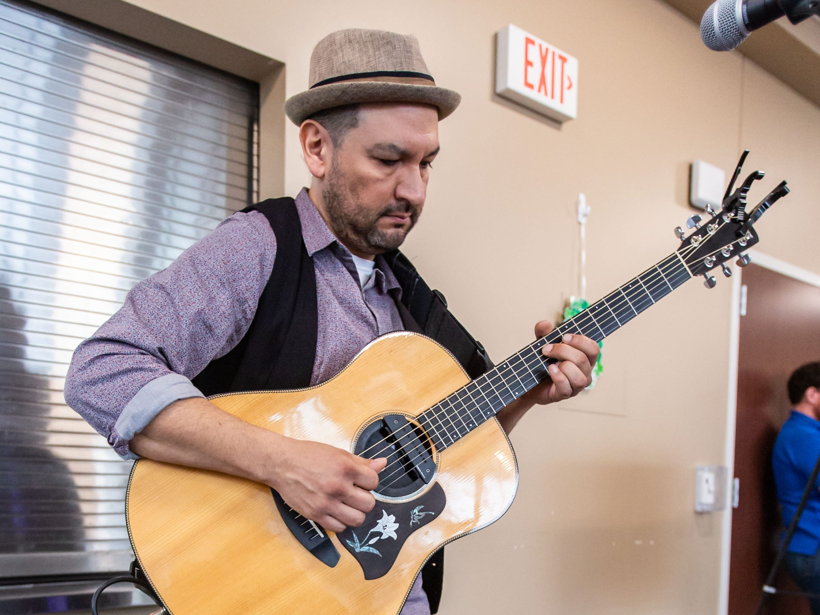 Singer songwriter Joey Leal of Waukesha entertains visitors during the Winter Farmers Market at the Sussex Civic Center on Sunday, March 10, 2019.