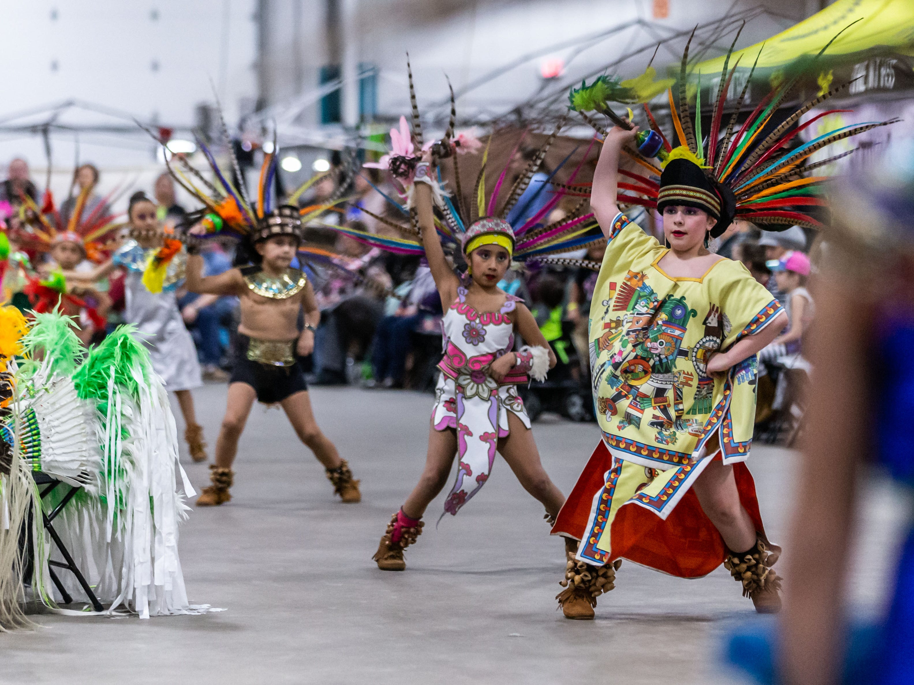Youth dancers from Milwaukee's Dance Academy of Mexico perform for spectators during the Indian Summer Festival's 28th annual Winter Pow Wow at Wisconsin State Fair Park on Sunday, March 10, 2019.