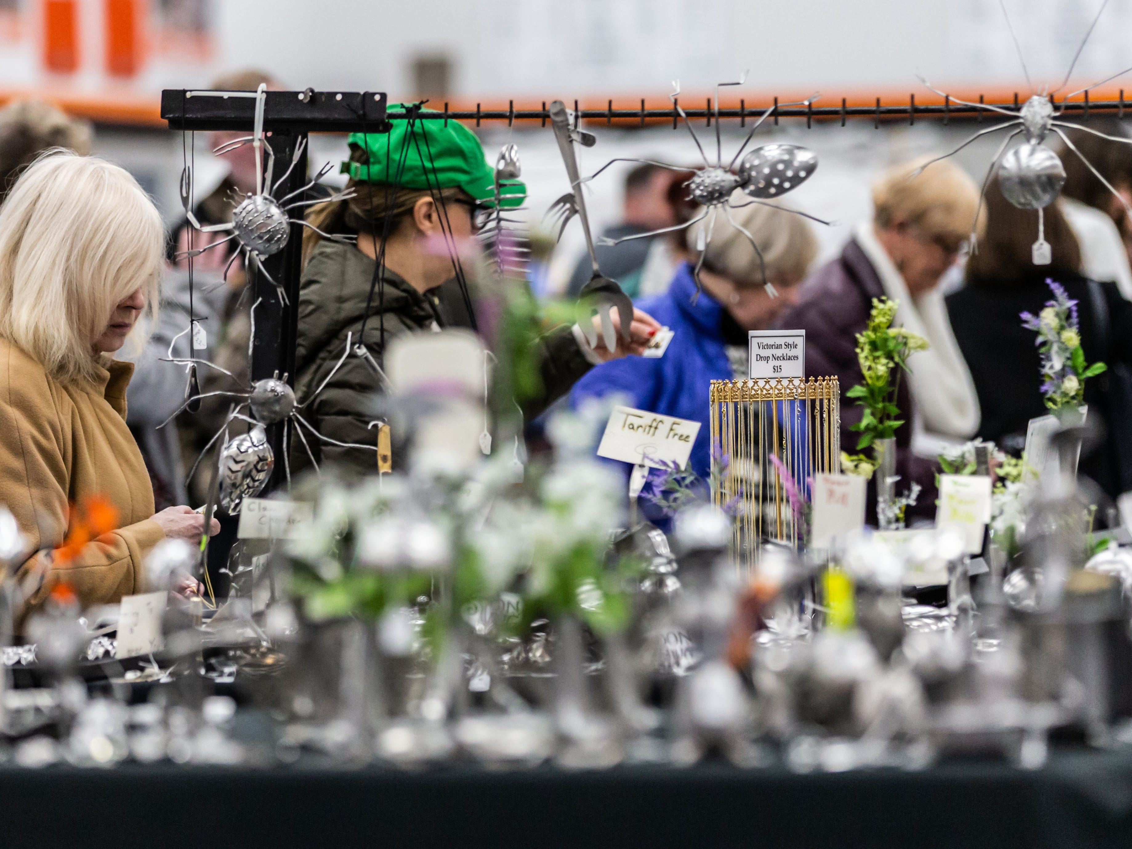 Attendees browse a variety of handcrafted offerings during the 7th annual Art in the Burg art fair at Cedarburg High School (CHS) on Saturday, March 9, 2019. The event, sponsored by the CHS Fine Arts Boosters and Art Department, features 75 artists from the midwest exhibiting and selling original work in many artistic disciplines.