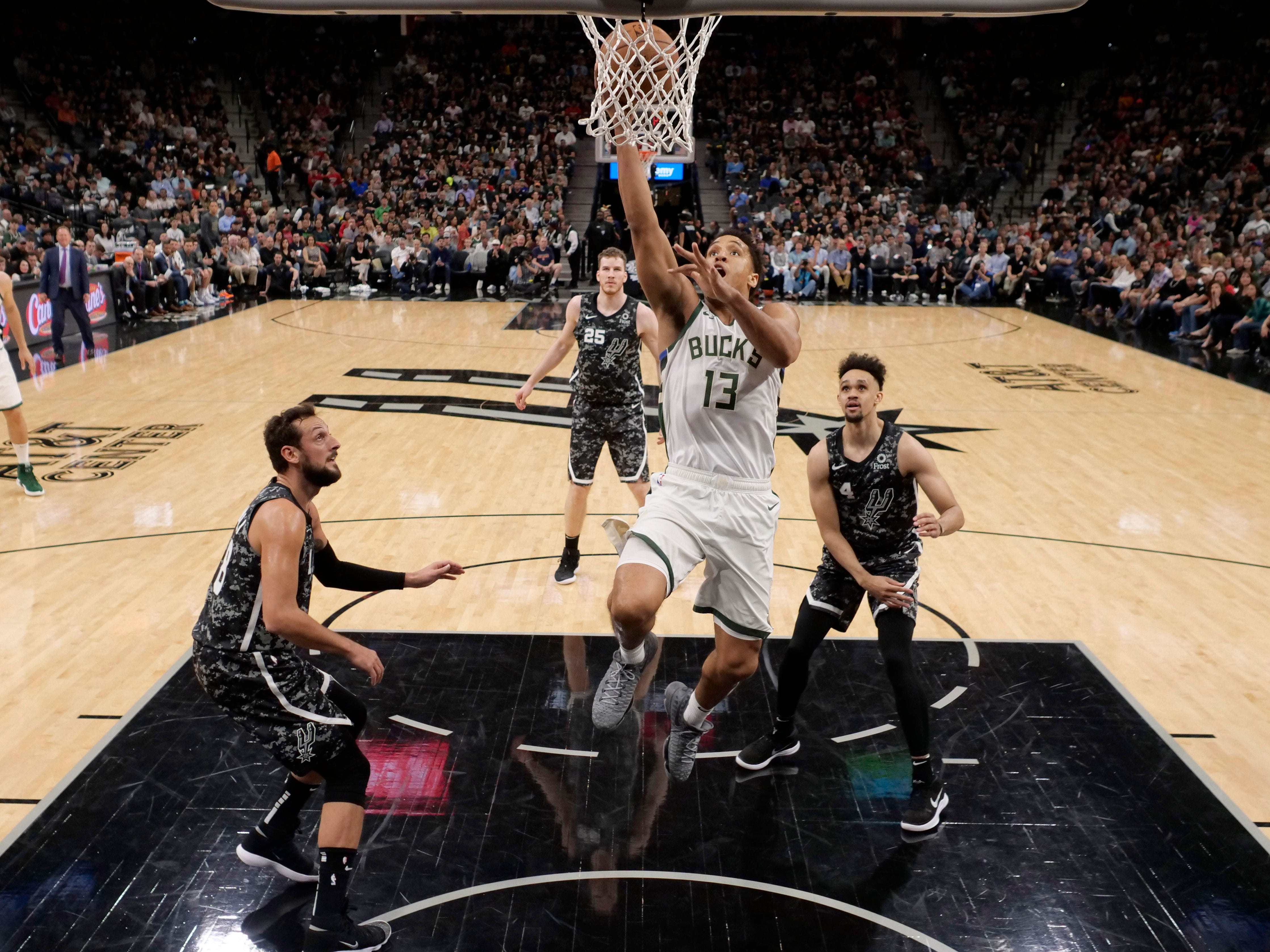 Bucks guard Malcolm Brogdon cuts through the Spurs defense for an uncontested layup during the first half Sunday.