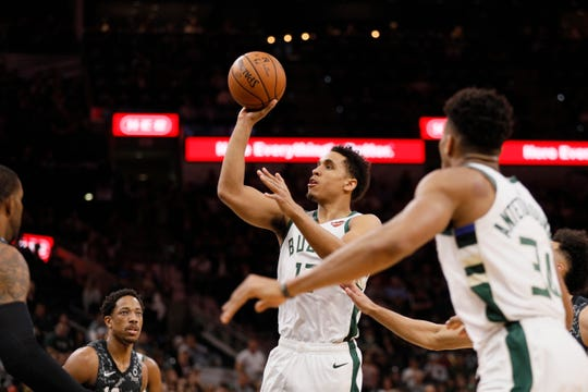Bucks guard Malcolm Brogdon goes up for a shot against the Spurs during the first half Sunday.