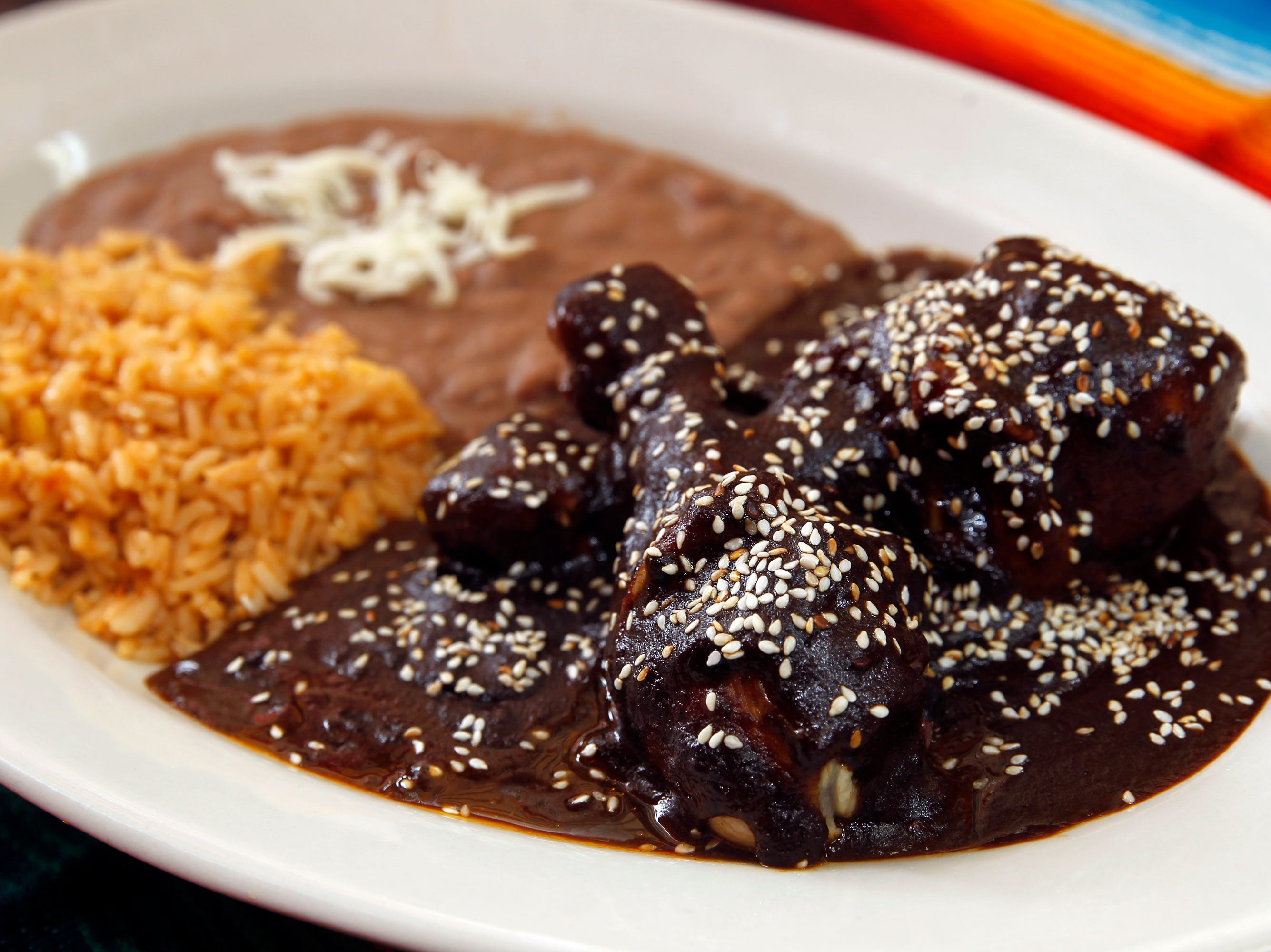 The Mole Poblano (chicken) from El Tlaxcalteca with rice and beans.
