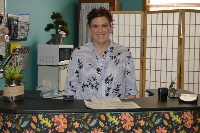 """Karissa Vitale Adam, owner of Vitality Massagein Waukesha, said she wanted to volunteer, but didn't have the time.So, she started organizing """"Share Kindness"""" events at her business."""