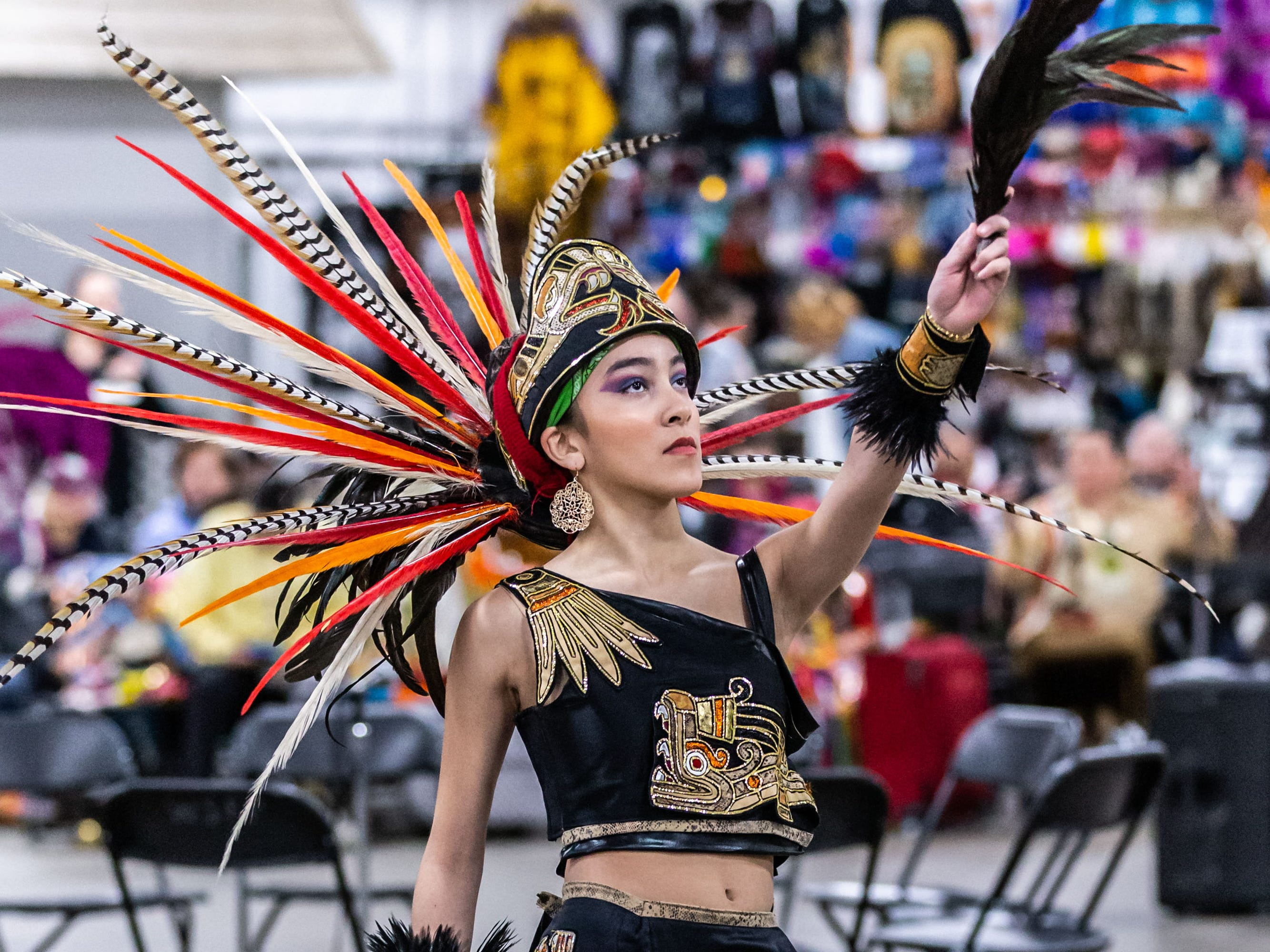 A dancers from Milwaukee's Dance Academy of Mexico performs for spectators during the Indian Summer Festival's 28th annual Winter Pow Wow at Wisconsin State Fair Park on Sunday, March 10, 2019.