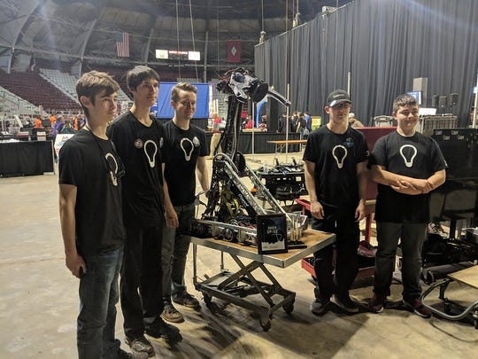 """The Mountain Home FIRST Robotics Competition Team 323, Lights Out, competed in thesixth annual Arkansas Rock City Regional atBarton Coliseum on the Arkansas State Fairgrounds in Little Rock. Lights Outjoined 58 other robotics teams from several surrounding states, Mexico, Brazil and Germany to play the 2019 challenge """"Destination: Deep Space.""""The team wonthe Industrial Design Award sponsored by General Motors for their robot """"Tomahawk."""" After being seededsecond, the team advanced to the semifinal matches of the double-elimination tournament. Lights Outwill be traveling to Peoria, Illinois, next week to compete at the Central Illinois Regional. Members of the team are: (from left)Gage Simmons, Chase Blum, Coach John Taylor Novak, Nick Huett andGeorge Smith."""