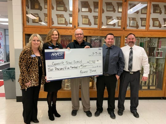 The Arvest Foundation recently presented representatives from the Gainesville, Mo.,school district with a donation in the amount of $2,500. Pictured are: (from left) Ashley Hambelton, Arvest Bank; Sally Gilbert, Arvest Bank; Dr. Jeff Hyatt, Gainesville School District Superintendent; Justin Gilmore, Gainesville High School Principal; and Butch Hoornstra, Gainesville School District Technology Coordinator.