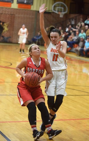 Norfork's Whitlee Layne is defended by Viola's Sami McCandlis during a game earlier this season. Both players received postseason honors on Monday, announced by the Arkansas Activities Association.
