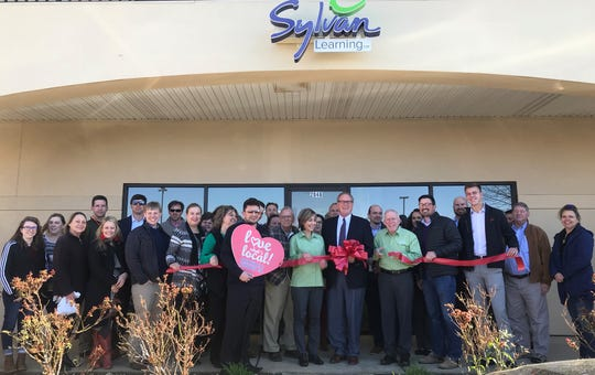 Officials cut a ceremonial ribbon at the opening of Sylvan Learning in Prattville.