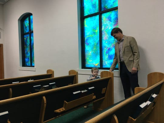 Before services Sunday morning at Pleasant Hill Baptist Church, 2-year-old Pratt follows his dad, Will Dismukes around the sanctuary.