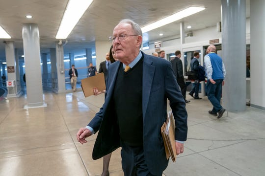 Sen. Lamar Alexander, R-Tenn., chairman of the Senate Health, Education, Labor and Pensions Committee, walks to the Senate for weekly policy meetings, at the Capitol in Washington, Tuesday, Feb. 12, 2019. (AP Photo/J. Scott Applewhite)