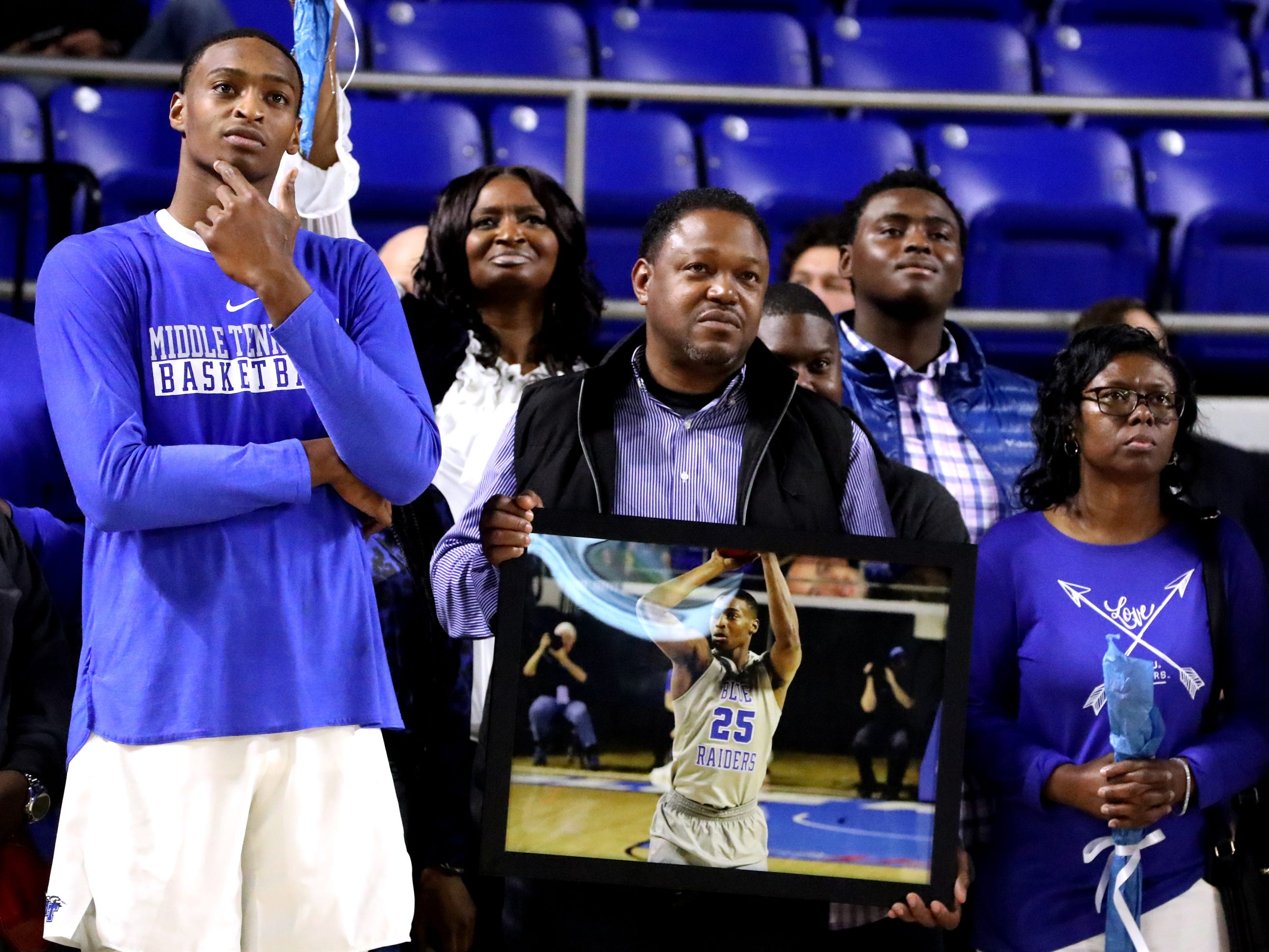 MTSU senior forward Karl Gamble (25) stands with his family as he was was honored during MTSU's senior night before the game against UTEP on Saturday, March 9, 2019, at Murphy Center in Murfreesboro, Tenn.