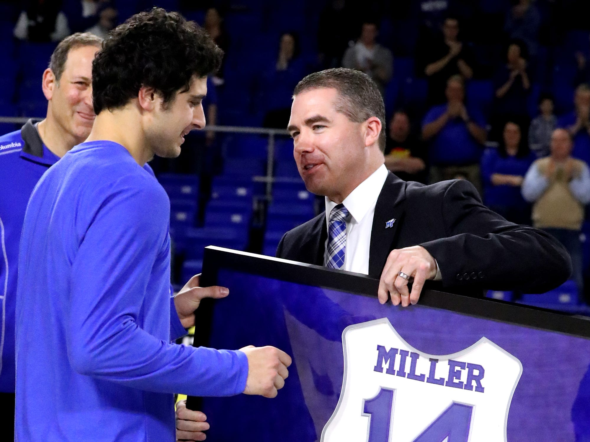 MTSU head coach Nick McDevitt honors MTSU guard Chase Miller (14) with a framed jersey during MTSU's senior night before the game against UTEP on Saturday, March 9, 2019, at Murphy Center in Murfreesboro, Tenn.