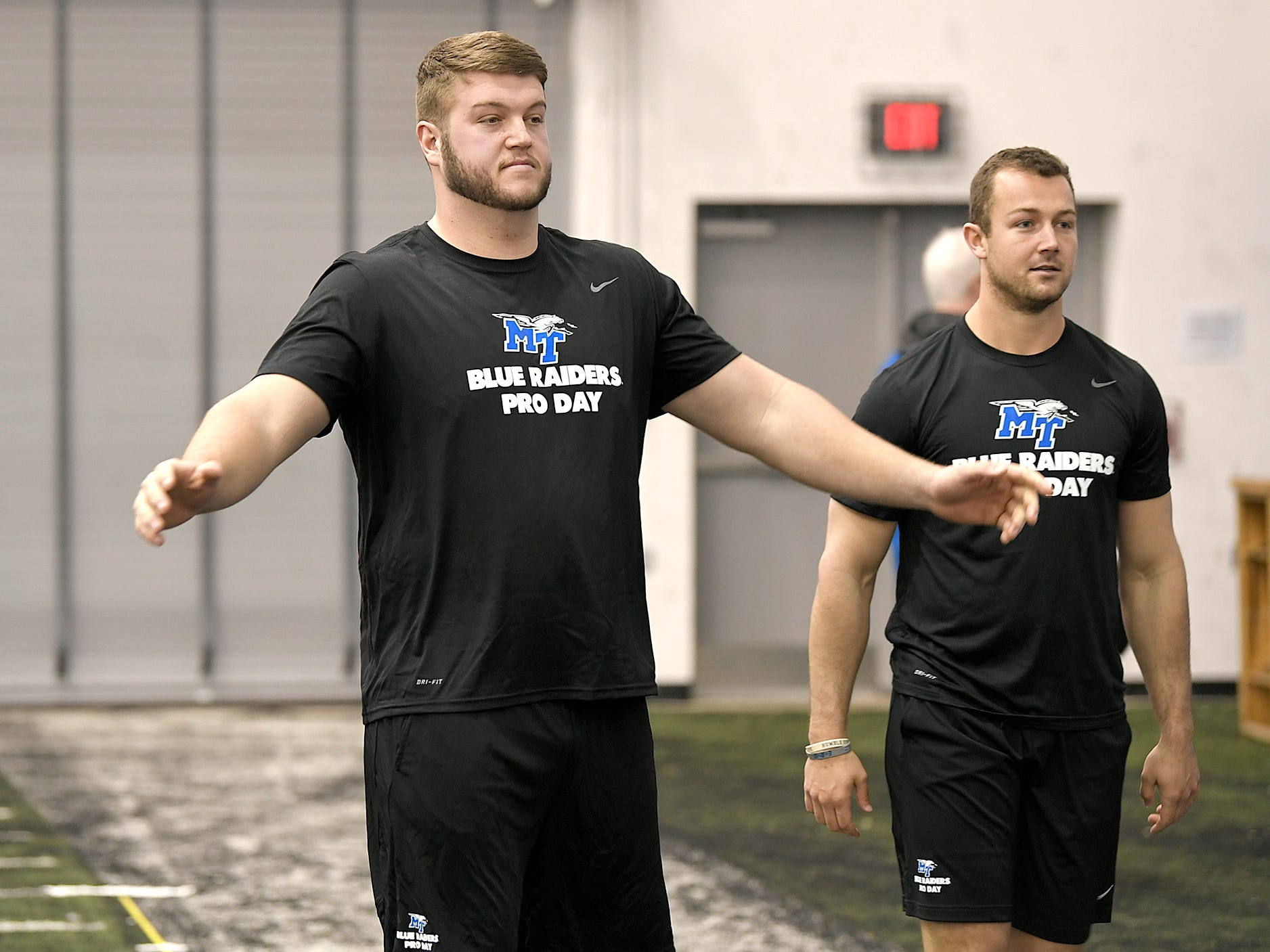 MTSU's Chandler Brewer and Brent Stockstill warm up before NFL Pro Day which was at TSU in Nashville on Monday, March 11, 2019.