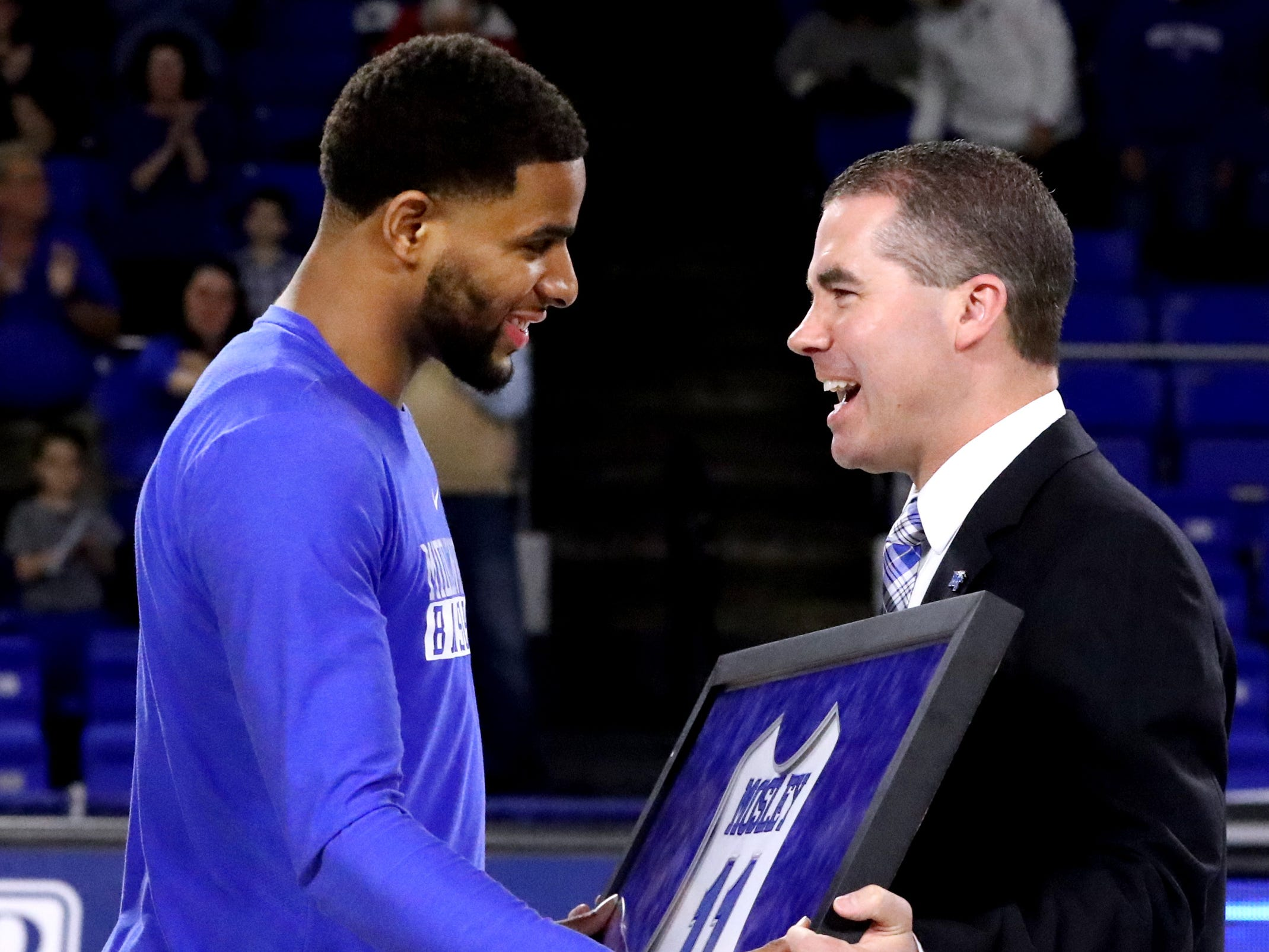 MTSU head coach Nick McDevitt honors MTSU senior guard Lawrence Mosley (11) with a framed jersey during MTSU's senior night before the game against UTEP on Saturday, March 9, 2019, at Murphy Center in Murfreesboro, Tenn.