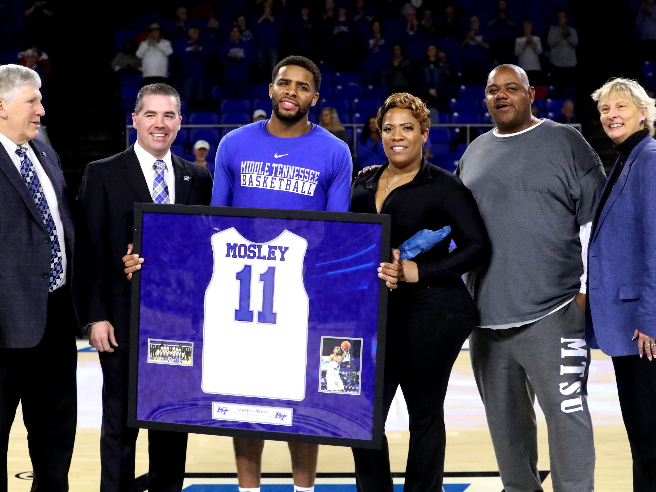 MTSU senior guard Lawrence Mosley (11) was honored on senior night before the game against UTEP on Saturday, March 9, 2019, at Murphy Center in Murfreesboro, Tenn.