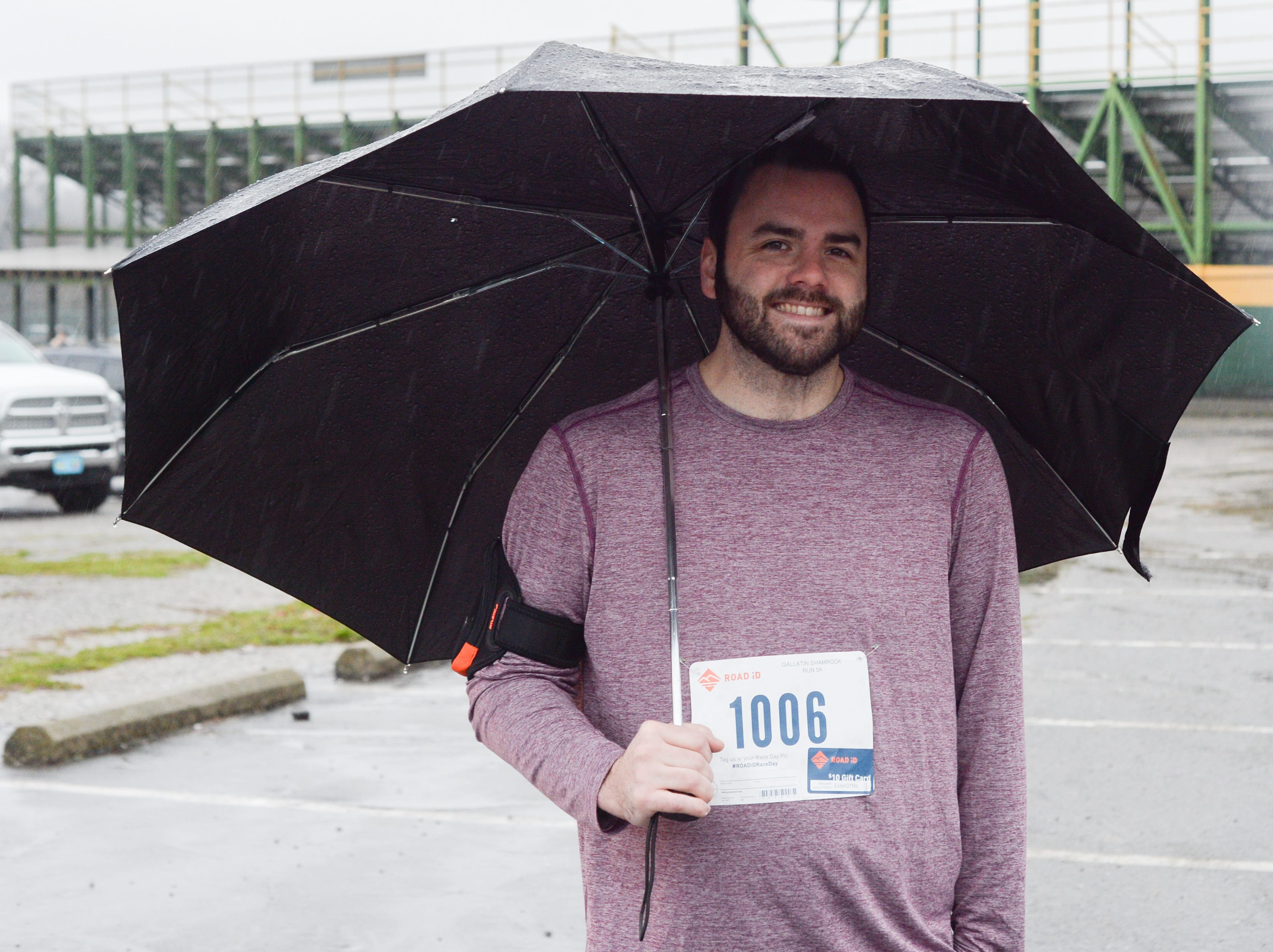 Josh Waugh tries to stay dry before the start of the Gallatin Shamrock Run on Saturday, March 9.