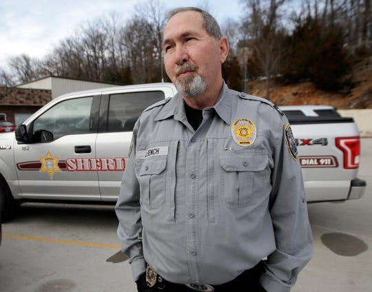 "In this Feb. 20, 2019 photo, Pulaski County Sheriff Jimmy Bench stands outside city hall in Waynesville, Mo. For painful, personal reasons, Bench wishes the Daily Guide was there to report on the December death of his 31-year-old son, Ryan, due to a heroin overdose. It would have been better than dealing with whispers and Twitter. ""Social media is so cruel sometimes,"" Bench said. (AP Photo/Orlin Wagner)"