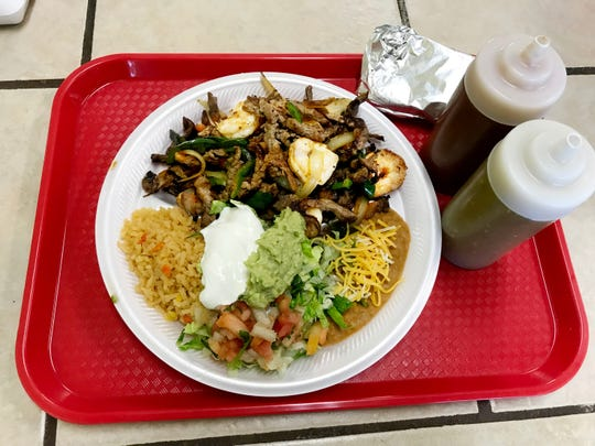 This fajita plate at $9.29 is a popular item on the Oscar's Taco Shop menu.