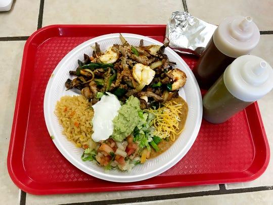 This fajita plate at $9.29 is a popular item on the Oscar's Taco Shop menu.