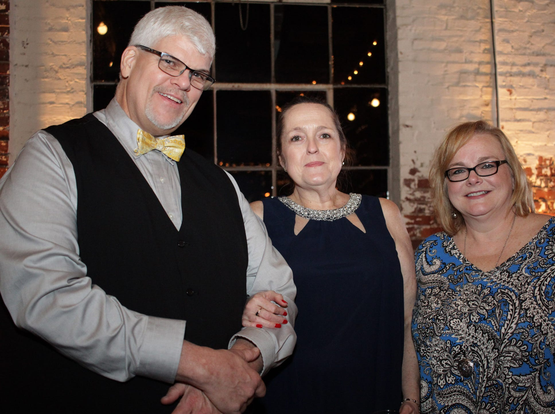 Paul and Peggy Sanders with Zena Parks at the Green and Gold Gala benefitting Gallatin HIgh School on March 9. 2019.