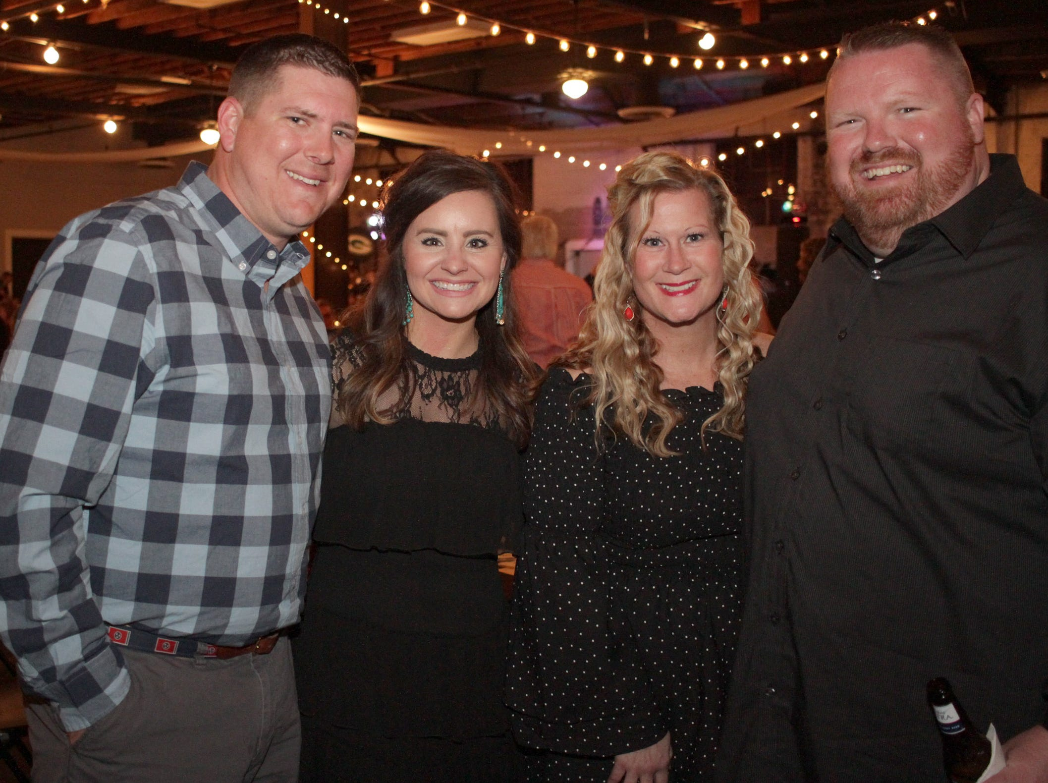 Stephen and Amy McKinzie with Niki and Steven Oldhan at the Green and Gold Gala benefitting Gallatin High School on Saturday, March 9, 2019.