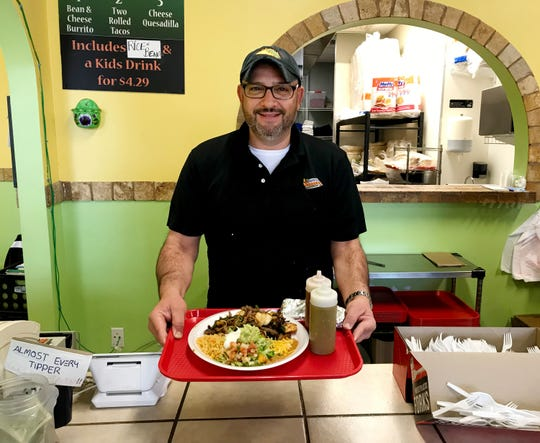 Javier Ruiz Jr. and his son own and operate the Oscar's Taco Shop in Cool Springs.
