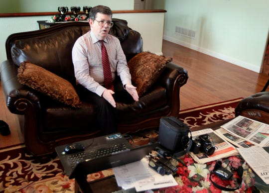 In this Feb. 20, 2019 photo, Facebook blogger Darrell Todd Maurina speaks during an interview at his house in Waynesville, Mo. Maurina says journalists need to go back to the basics to survive, or revive, in small-town America. (AP Photo/Orlin Wagner)
