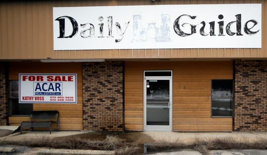 In this Feb. 19, 2019 photo, the old Daily Guide office stands for sale in St. Robert, Mo. With the shutdown of the newspaper in September 2018, this area in central Missouri's Ozark hills joined more than 1,400 other cities across the United States to lose a newspaper over the past 15 years, according to an Associated Press analysis of data compiled by the University North Carolina. (AP Photo/Orlin Wagner)
