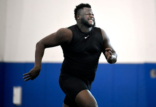 TSU offensive lineman Chidi Okeke runs the 40-yard dash during TSU's Pro Day on Monday.