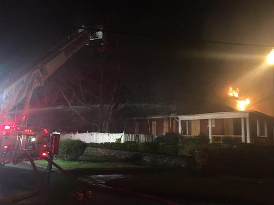 Firefighters are putting out a house fire in the 1000 block of Monroe Street on Sunday, March 10, 2019.