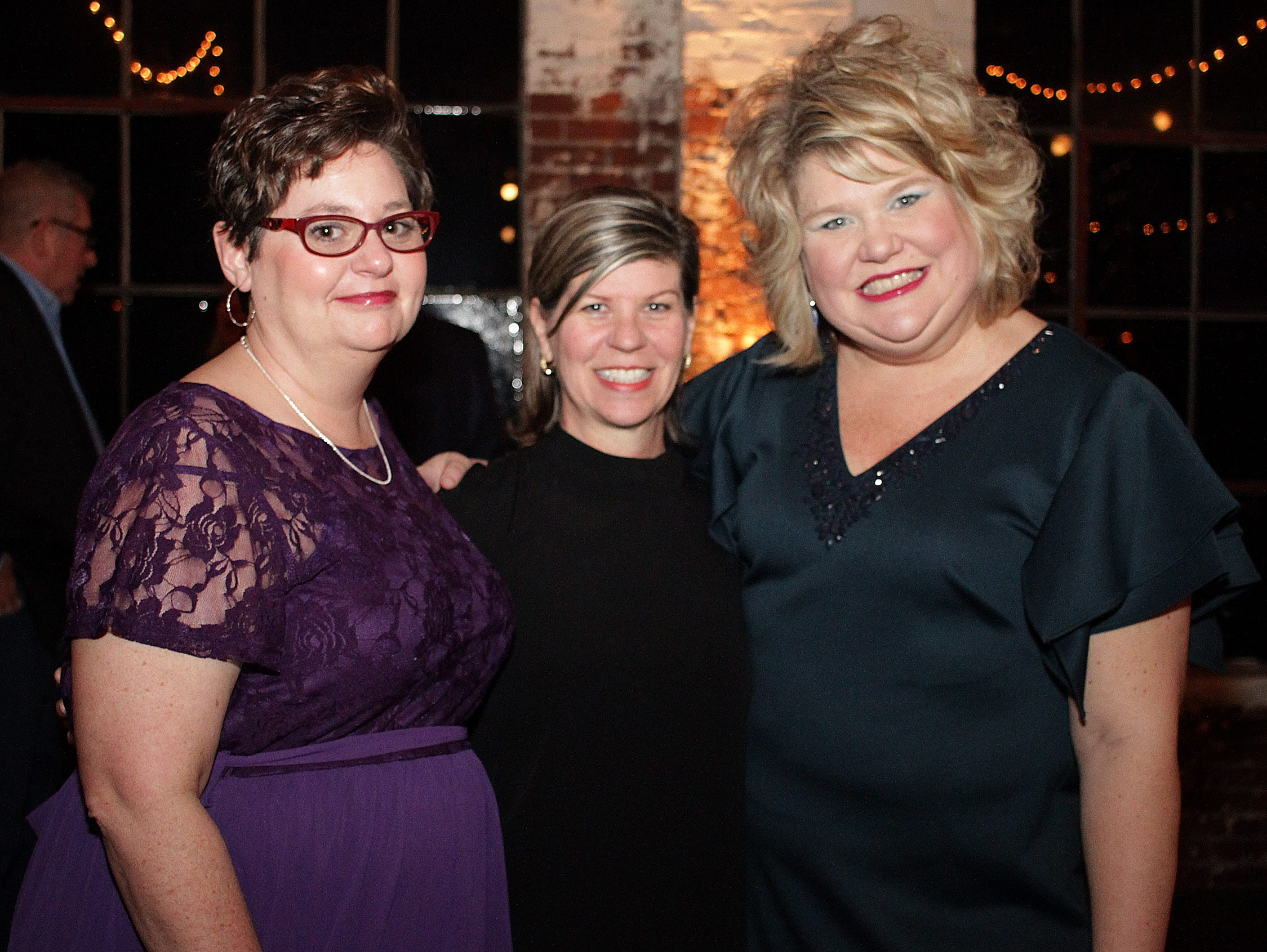 L-R Paula Simmons Tina Baber and Stephanie Harville attending the Green and Gold Gala benefitting Gallatin High School on Saturday, March 9, 2019.