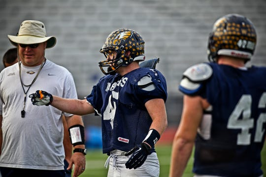 Naples High defensive coordinator talks to his linebackers during a practice in 2012. After 21 seasons leading the Golden Eagles defense, including winning two state titles, Dollar is leaving Naples to be defensive coordinator at Mustang High School in his home state of Oklahoma.