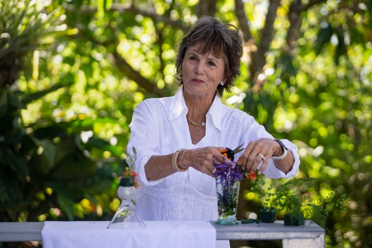 Floral designer Mary Raymond, of Naples, works on a floral arrangement, Thursday, March 7, 2019, during a floral arrangement demonstration at the Naples Botanical Garden.