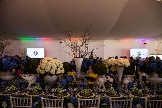 "A table designed by Anthony Catalfano with the theme ""Nantucket Summer Garden Party"" is on display at the League Club of Naples annual fundraiser at the Ritz-Carlton Golf Resort in Naples on March 11, 2019. Catalfano said that some of the flowers were imported from Holland for the event."