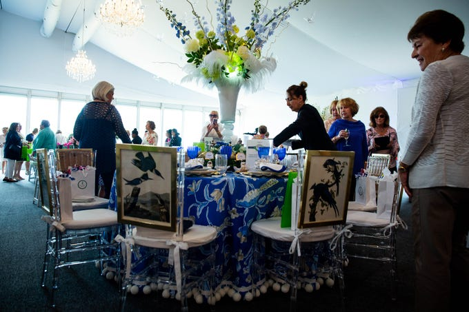 Attendees at the League Club of Naples annual fundraising luncheon admire a table designed by Stacey and Shari Summers at the Ritz-Carlton Golf Resort in Naples on March 11, 2019.