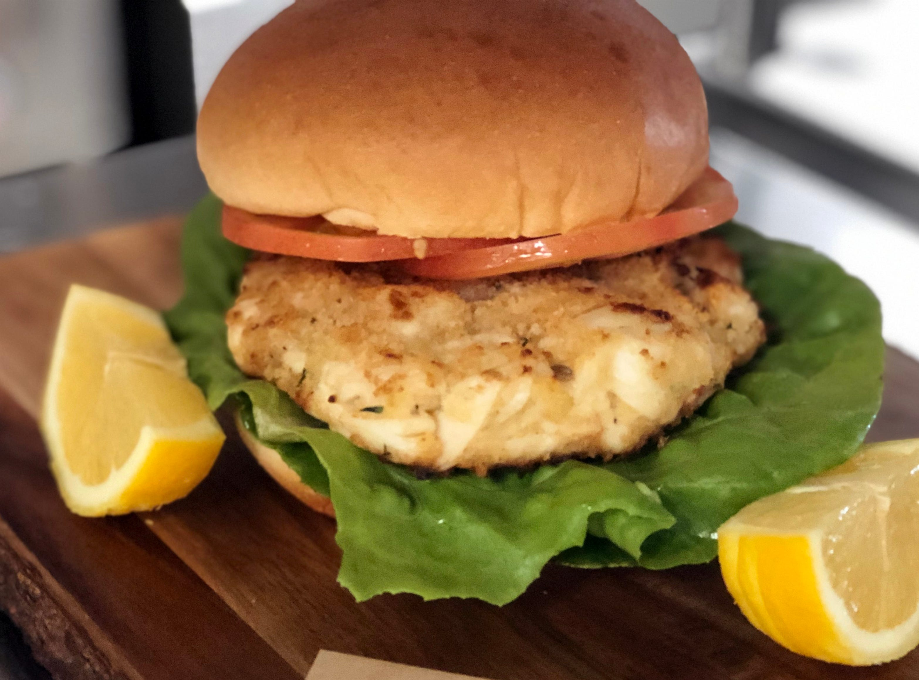 The Crab Sammie features a jumbo lump crab cake served on a brioche bun with lettuce, tomato and lemon parsley aioli at Locale Eatery in North Naples.