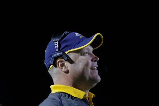 Naples High defensive coordinator Sam Dollar beams as his squad shuts out Bayside during the 2014 playoffs. Dollar is leaving the Golden Eagles after 21 seasons with the program, taking a job as defensive coordinator at Mustang High School in his home state of Oklahoma.