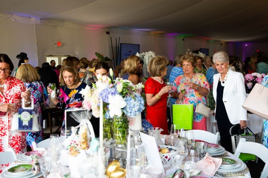 Attendees at the League Club of Naples annual fundraiser admire tables at the Ritz-Carlton Golf Resort in Naples on March 11, 2019.