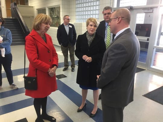 First Lady Fran DeWine and Dorothy Pelanda chat with Granville Schools Superintendent Jeff Brown (left) during a March 11 schools' visit.