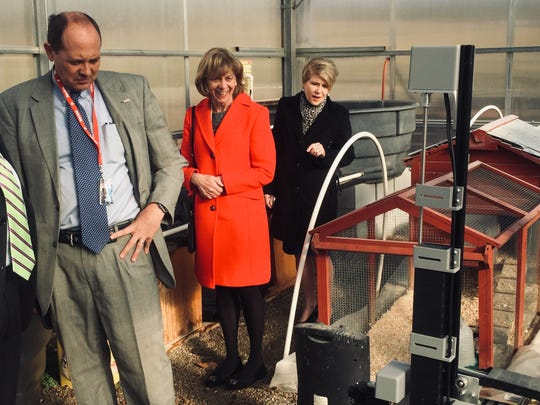 """State Senator Jay Hottinger, First Lady Fran DeWine and Ohio Department of Agriculture Director Dorothy Pelanda are given a look at a Granville Schools' """"farmbot"""" that can plant seeds and be directed via smart phone."""