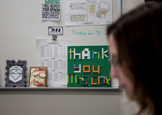 Shannon Cox, Johnstown's In-School-Support teacher works at her desk framed by thank you notes from students. Cox started off as an In-School-Suspension teacher but has been so effective at her job she has shifted into a support role helping kids before they cause trouble.